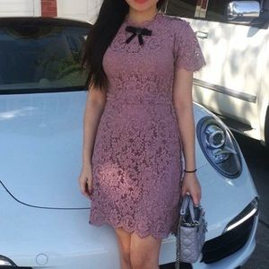 Pink lace dress with black bow